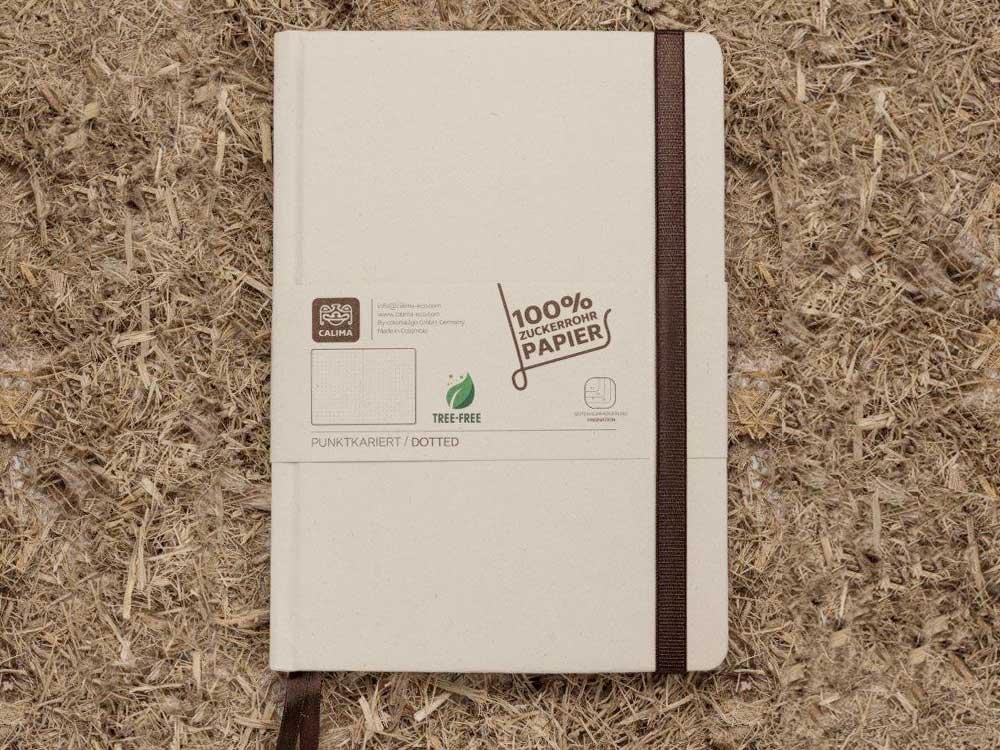 Kiss My World, Calima, Notizbuch, A5, Zuckerrohrpapier, Vorderansicht, Fasern, Hintergrund
